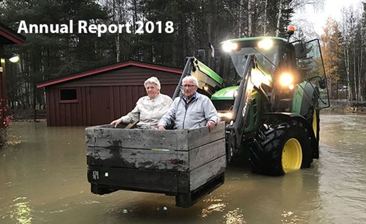 Old couple carried away from flooding by tractor